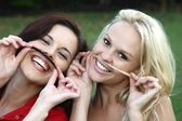Friends Having Fun with Pretend Moustaches — Stock Photo