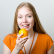 Cute girl with an orange — Stock Photo #8413740