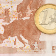 One Euro Coin on Euro Banknote showing Map of Europe — Stock Photo #10165343