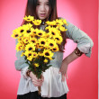 A Beautiful Chinese girl with many flowers. — Stock Photo #10098898