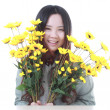 A Beautiful Chinese girl with many flowers. — Stock Photo