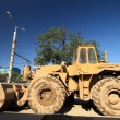 Stok fotoğraf: Heavy Duty Construction Equipment Parked at Worksite
