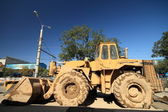 Heavy Duty Construction Equipment Parked at Worksite — ストック写真