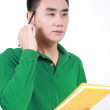 Student reading a book with a white background. — Stock Photo