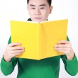 Student reading a book with a white background. — Stock Photo #9467829