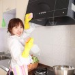 A Chinese woman is cleaning in the kitchen. — Stock Photo #9483584