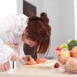 A Chinese woman is cooking various kinds vegetable. — Stock Photo #9484371