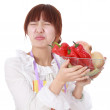 A Chinese woman with vegetable isolated on white. — Stock Photo