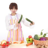 A Chinese woman is cooking various kinds vegetable. — Stock Photo