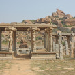 Indian temple ruin infront of massive rock boulders - Stock Photo