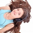 Nice teen girl  listening to music - Stock Photo