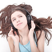 Nice teen girl listening to music — Stock Photo