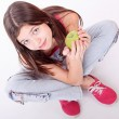 Young woman rith green fresh apple - Stok fotoraf