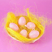 Pink eggs in the basket — Stock Photo