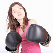 Beautiful young teen girl boxing — Stock Photo