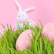 Egg easter in a grass on lilac - Stock Photo