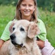 Little girl and her beloved dog — Stock Photo #9011997