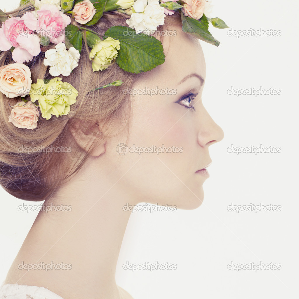 Beautiful young woman with delicate flowers in their hair — Stock Photo #8760937