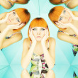 Bright redhead woman in kaleidoscope - Stock Photo