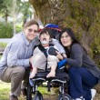 Stock Photo: Disabled child surrounded by parents