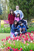 Family with disabled boy in the tulips gardens — Stock Photo