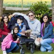 Family with disabled boy in tulips gardens — Stok Fotoğraf #10562074