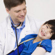 Stock Photo: Male doctor holding disabled toddler patient on lap