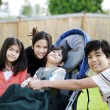 Stock Photo: Three children surrounding small disabled child in wheelchair