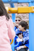 Father playing at playground with disabled son — Stock Photo