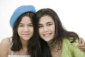 Two teen girls smiling together, hugging. — Stock Photo