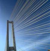 Fragment of the Southern bridge against a clear blue sky. — Stock Photo