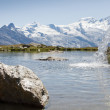 Alpine lake with waterfall — Stock Photo