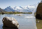 Alpine lake with waterfall — Stock Photo
