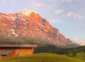 Mountain hut with alpenglow, Switzerland — Stock Photo