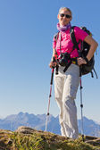 Woman hiking in high mountains — Stock Photo