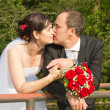 Kiss of bride and groom after wedding — Stock Photo