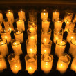 Orange votive candles — Stock Photo