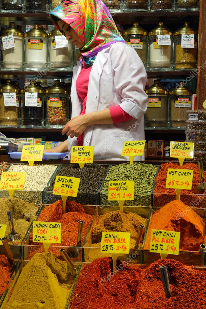 Displays of products on offer in the world famous Spice market and shopkeeper with headscarf  in Istanbul Turkey  — Stock Photo #8099696