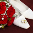 Weddin concept with rings flowers and shoes — Stock Photo #8100089