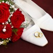 Weddin concept with rings flowers and shoes - Stock Photo