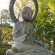 Stockfoto: Buddhstatue in park with protection gesture