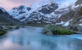 Glacier stream at sunset Switzerland — Stock Photo