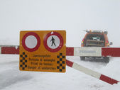 Road closed to snow and avalanche danger — Stock Photo