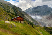 Timber hut with Aletsch glacier — Stock Photo