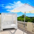 Royalty-Free Stock Photo: Bed and parasol on the terrace under the sun