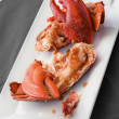 Lobster on white dish — Stock Photo