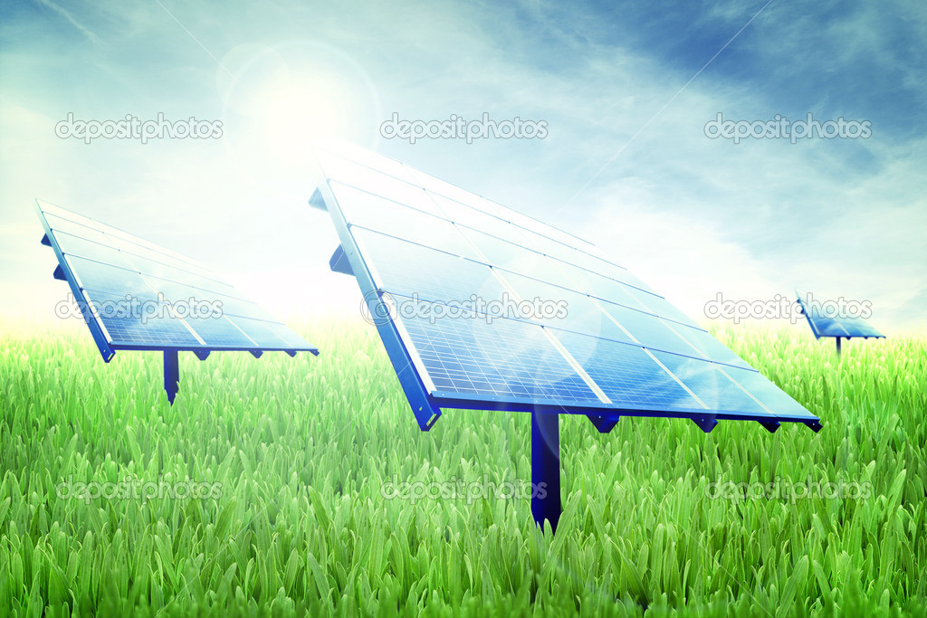 Photovoltaic panels in a green field of grass — Stock Photo #8341655