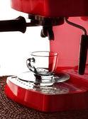 A glass cup and espresso machine — Stock Photo