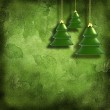 Christmas toys on decorative grunge background with green leaves — Stock Photo #7967384