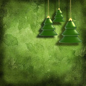 Christmas toys on decorative grunge background with green leaves — Stock Photo